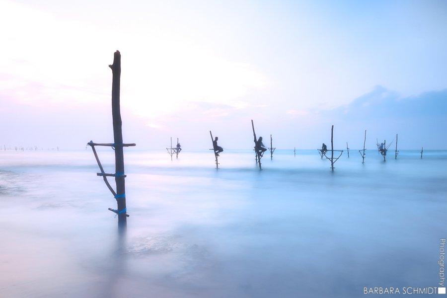 © Barbara Schmidt, Stilt-fishing